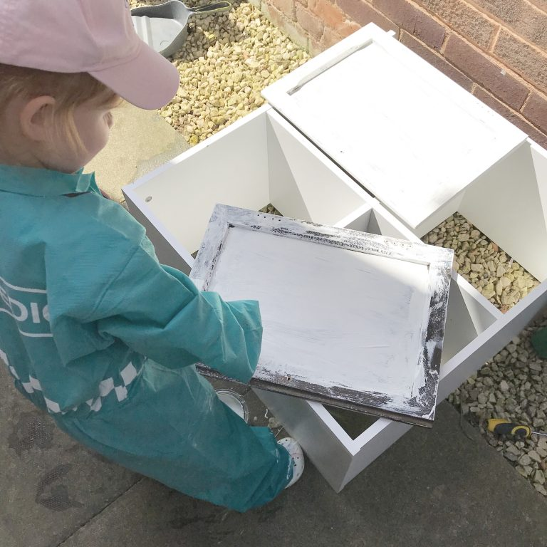Amelia helping paint the cupboard doors of the welsh kitchen dresser that we have upcycled using rust oleum chalk paint