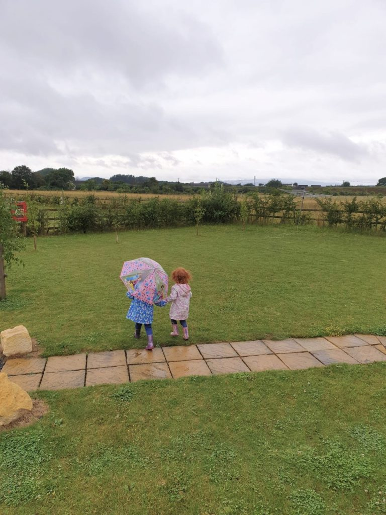 Amelia and Lilly playing in the rain at Northwick Farm Lodges