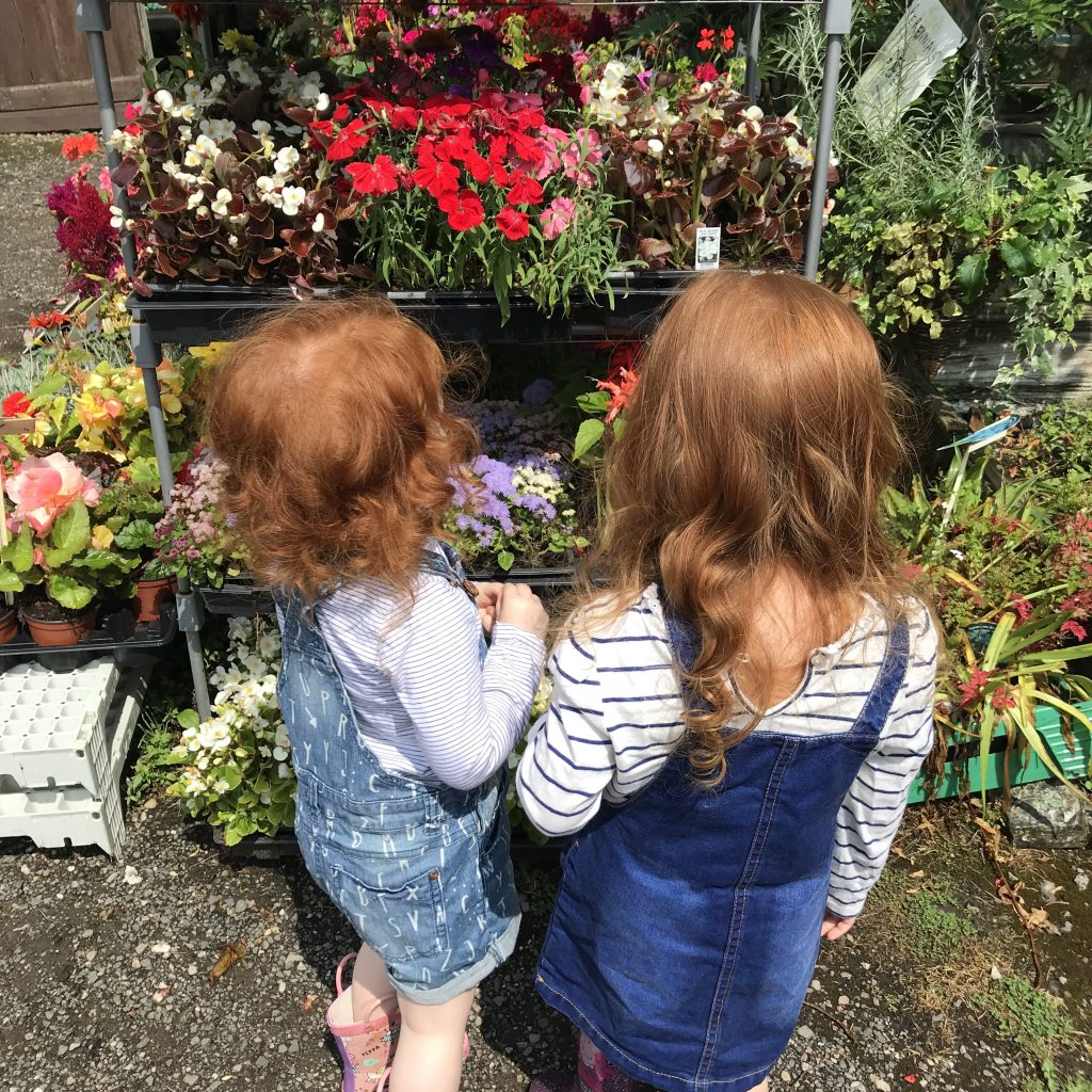 Two girls selling flowers at Caldicott's Nursery in Solihull