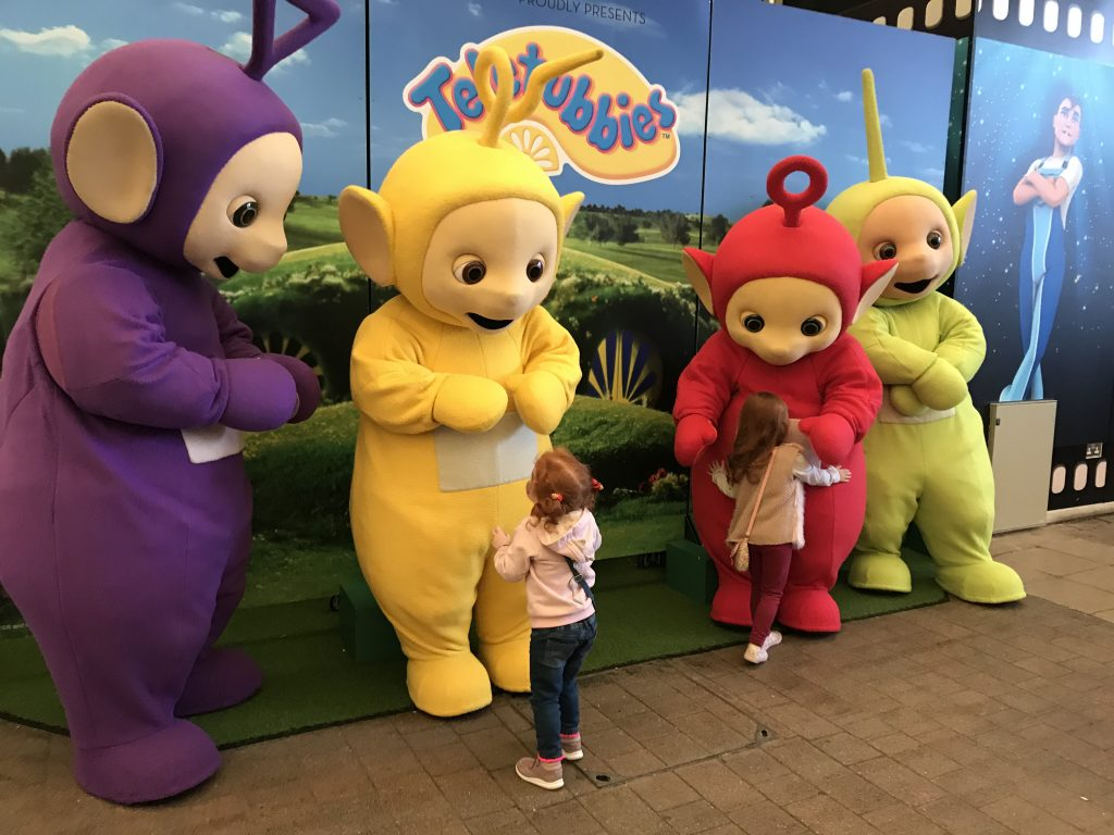 A photo of two girls with the Teletubbies  at Butlins Minehead
