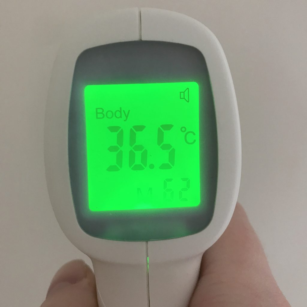 A no touch thermometer displaying 36.5 degrees