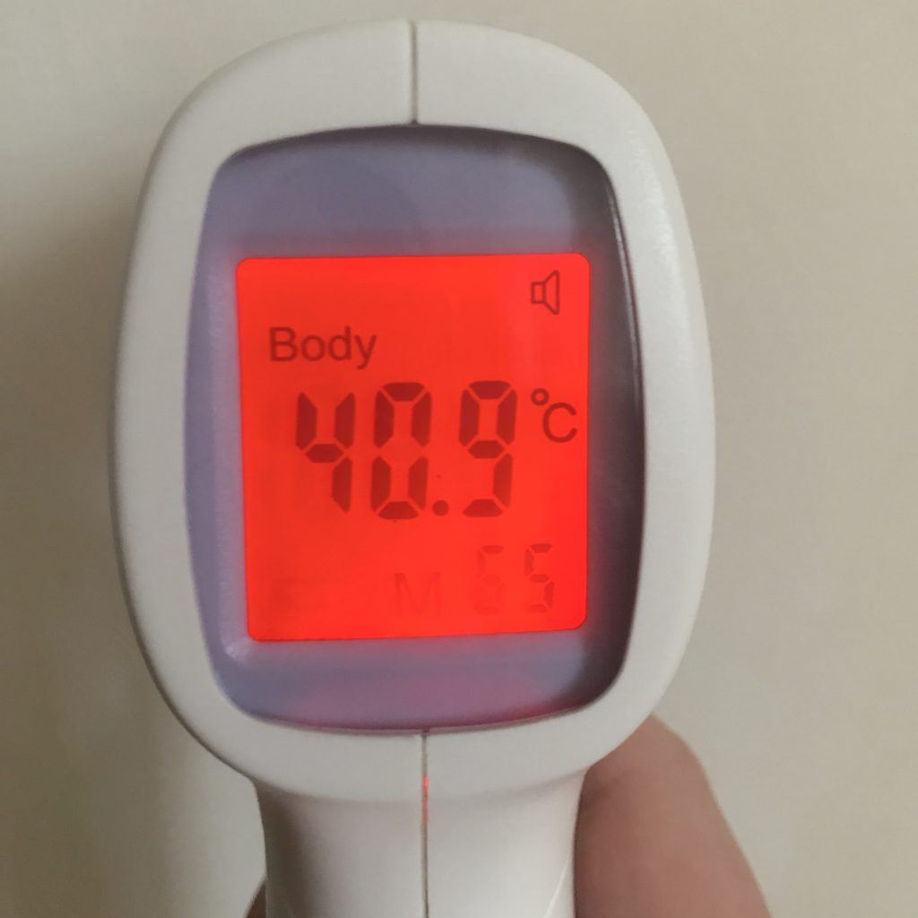 A no touch thermometer displaying 40.9 degrees